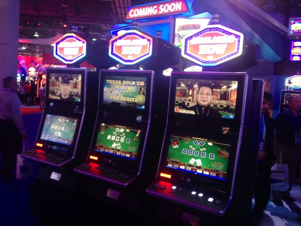 PIC: the brand spanking new Phil Hellmuth and Johnny Chan Pro Series Video Poker Machine on #g2e floor right now!!