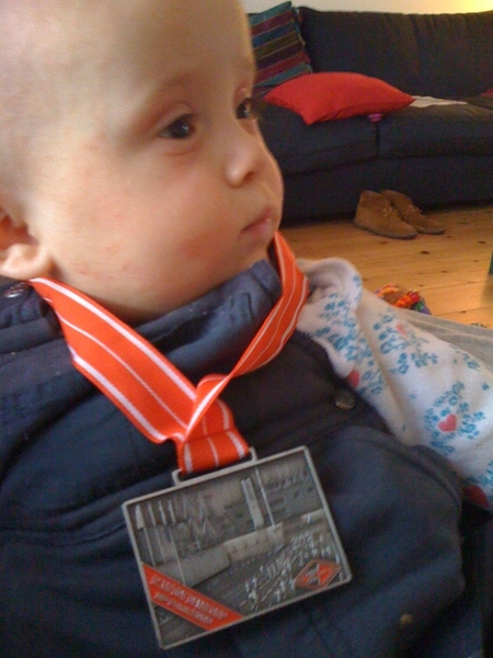 Annemijn is also proud of my medal for the 10 Mile run I did today.
