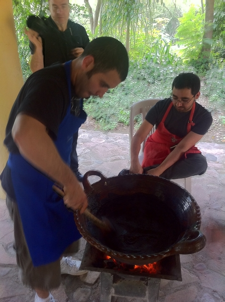 Susana Trilling Oax cooking school: chef Joel & my asst Jeff cooking the chile puree until thick and shiny