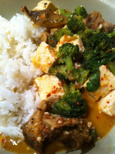Dinner of Thai red curry (brot curry paste frm Thailand) w local hen o woods shrooms, broccoli, tofu,backyrd basil
