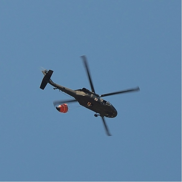 Helicopter flyover still dumping water on the Camp Bullis area... #satxwildfire