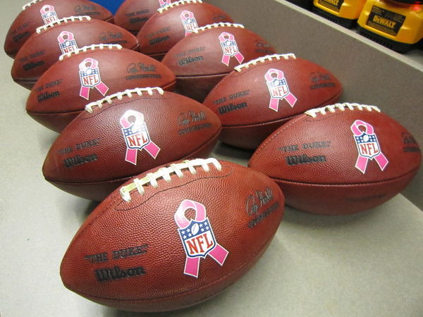 Pink-ribbon footballs ready for Sunday and the start of breast cancer awareness month