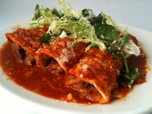 Frontera menu chg hilite: goat birria enchiladas with garlicky red chile sauce, frisee, watercress, queso añejo