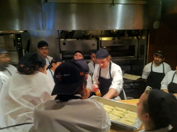 Chef Zach schooling chefs on the presentation of each dish 4 tonight's special dinner