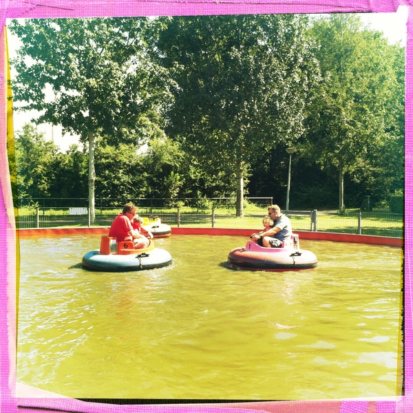 Big and little kids on the bumper boats